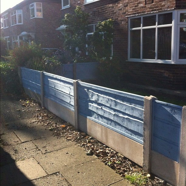 The house with the blue fence