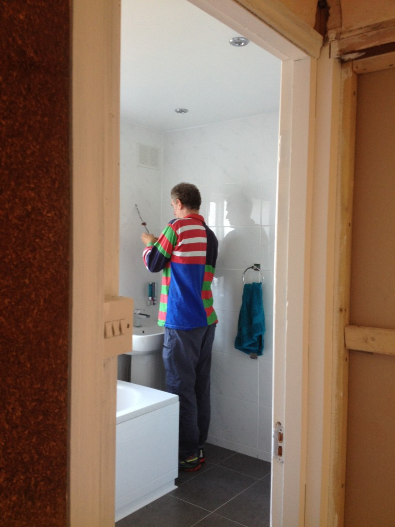 Peter preparing the wiring for the bathroom light