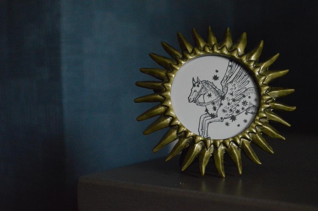 gold sun frame